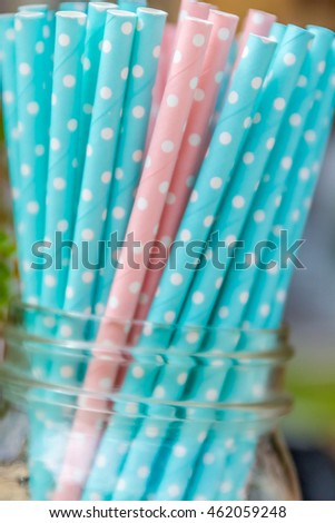 Colorful paper straws for birthday party on natural background