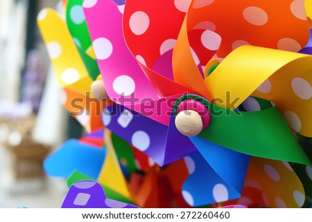 colorful paper windmil close up with soft focus - stock photo