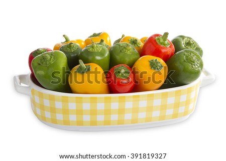 Colorful paprica in a beautiful bowl isolated on white background