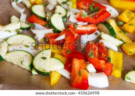 Colorful paprika onion zucchini fennel on oven tray prepared for baking
