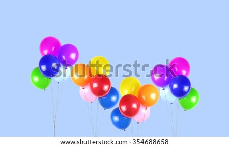 Colorful party balloons on blue background - stock photo