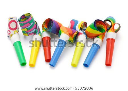Colorful party blowers arranged in a row on white - stock photo