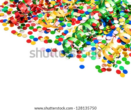 colorful party decoration with confetti and shiny streamer over white background - stock photo