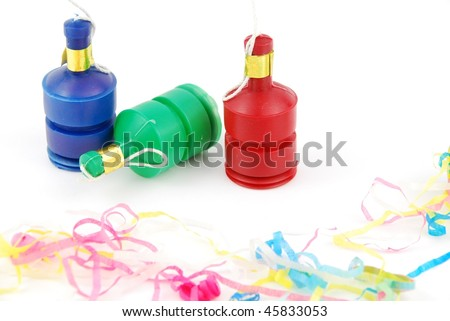 colorful party poppers isolated on white background