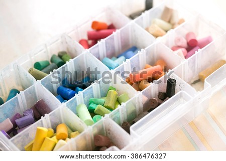 Colorful pastel chalks in box. Close-up