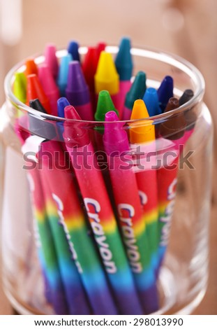 Colorful pastel crayons in glass holder, closeup - stock photo