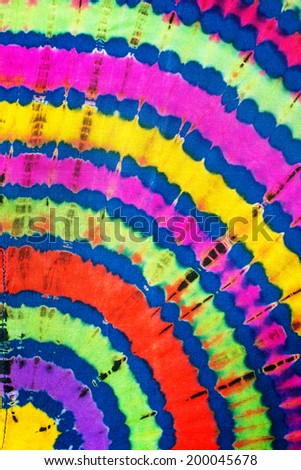 Colorful pattern of tie-dye clothing - stock photo