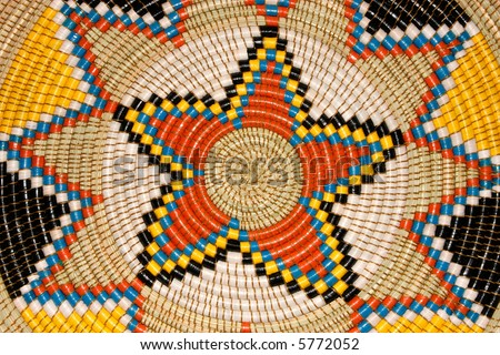 Colorful pattern on a hand woven African basket - stock photo