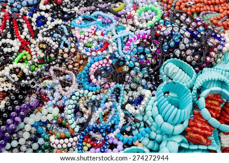 colorful pearl necklaces and bracelets background