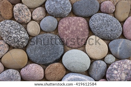Colorful pebbles on sand - stock photo