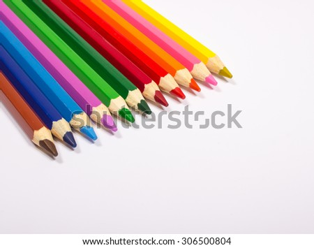 Colorful pencil crayons isolated on white, closeup.