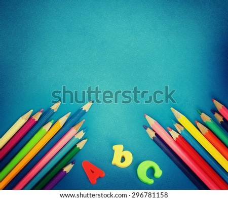 Colorful pencil crayons on a blue background. Back to school - stock photo