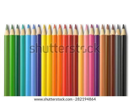 Colorful pencil crayons on a white background - stock photo
