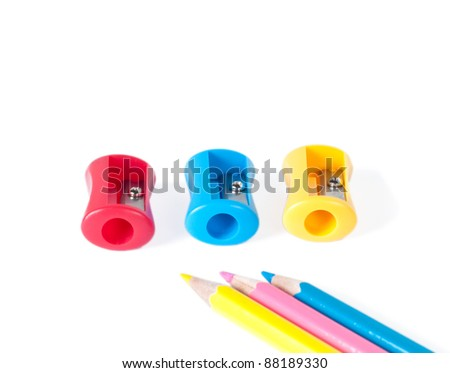 Colorful pencil sharpeners and pencils isolated on white background - stock photo