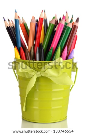 Colorful pencils and felt-tip pens in green pail isolated on white - stock photo