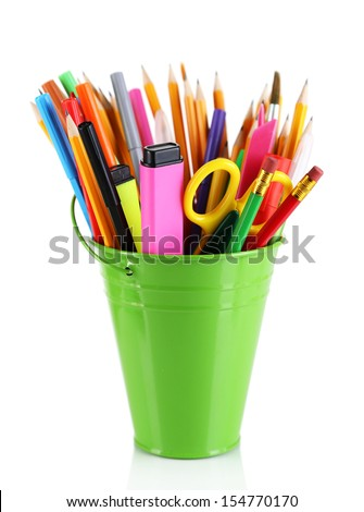Colorful pencils and other art supplies in pail isolated on white - stock photo