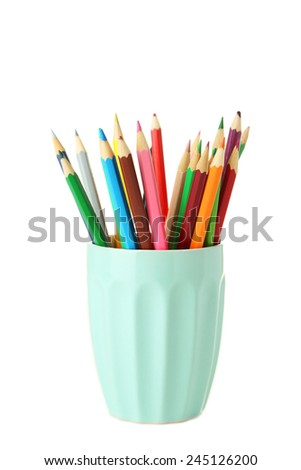 Colorful pencils in cup isolated on white - stock photo