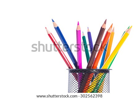Colorful pencils in pencil stand - stock photo