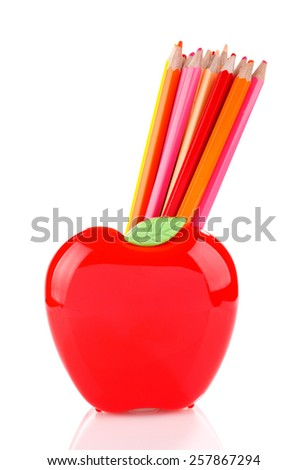 Colorful pencils in red apple shaped holder isolated on white - stock photo