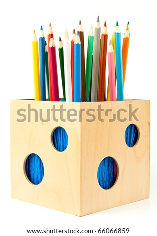 Colorful pencils in wooden holder over white