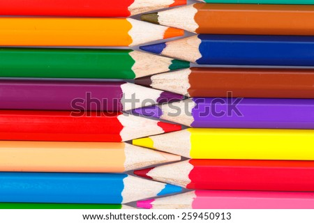 Colorful pencils isolated on white background close up