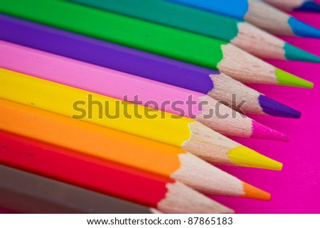 colorful pencils on pink background