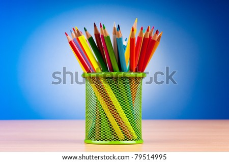 Colorful pencils on the background
