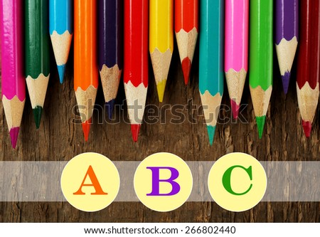 Colorful pencils, on wooden background - stock photo