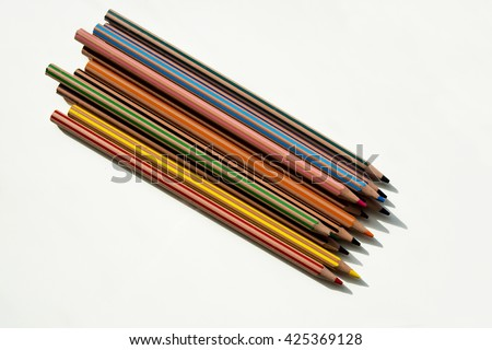 Colorful pencils, tied together, different colors