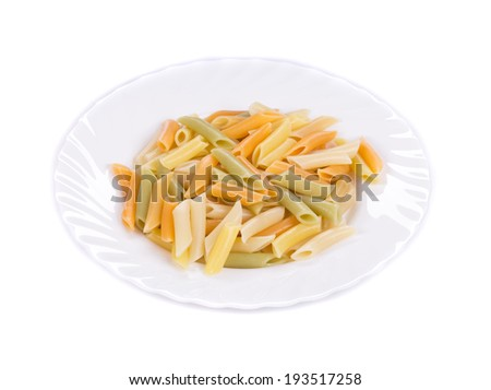 Colorful penne pasta. Isolated on a white background.