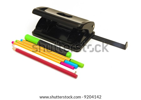 Colorful pens pencils highlither and hole puncher isolated on white.