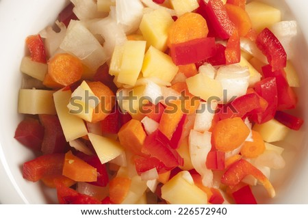 colorful pepper and onion cut in cubes  - stock photo