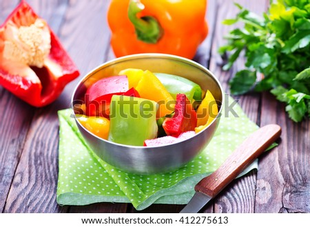 Colorful peppers on rustic wooden table
