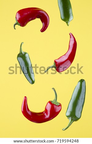 Colorful peppers set against a yellow background.