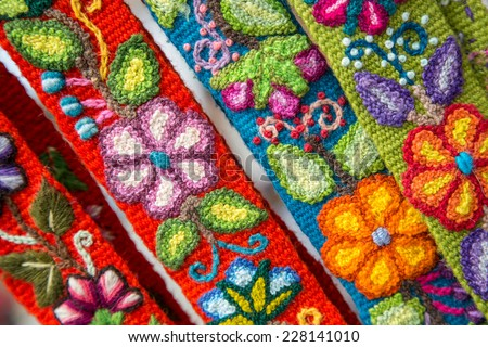 Colorful, Peruvian embroided flowers on textile - stock photo