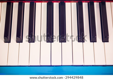 Colorful Piano keyboard background with selective focus - stock photo