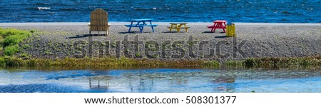 Colorful picnic tables at the ocean side