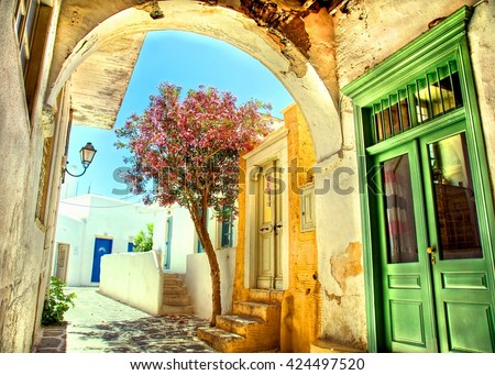 colorful picturesque neighborhood on the cyclade islands of Geerce - stock photo