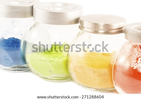 Colorful pigments in the glass jars