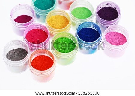 Colorful pigments powders background - stock photo