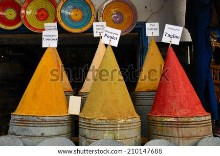Colorful piles of powdered spices in moroccan spice market in medina of Fes, Morocco - stock photo