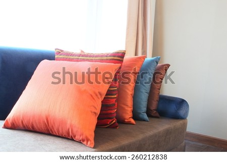 Colorful Pillow on hotel bed - stock photo