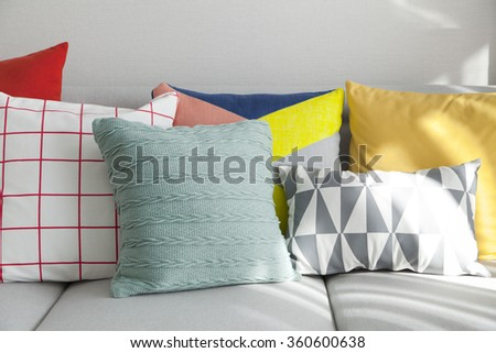 Colorful pillows on a sofa  - stock photo