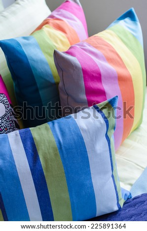 colorful pillows on bed