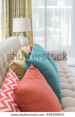colorful pillows on classic sofa style in living room with white lamp