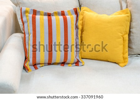 colorful pillows on grey sofa