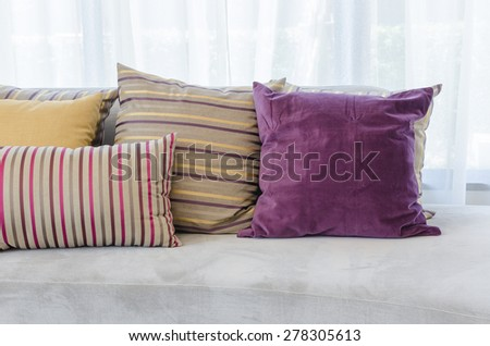 colorful pillows on modern sofa in living room at home
