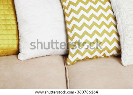 Colorful pillows on sofa close up - stock photo