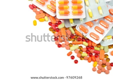 colorful pills and blisters on a white background - stock photo