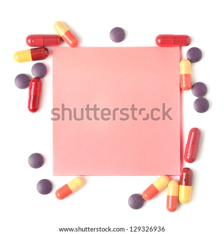 Colorful pills and paper for notes isolated on white